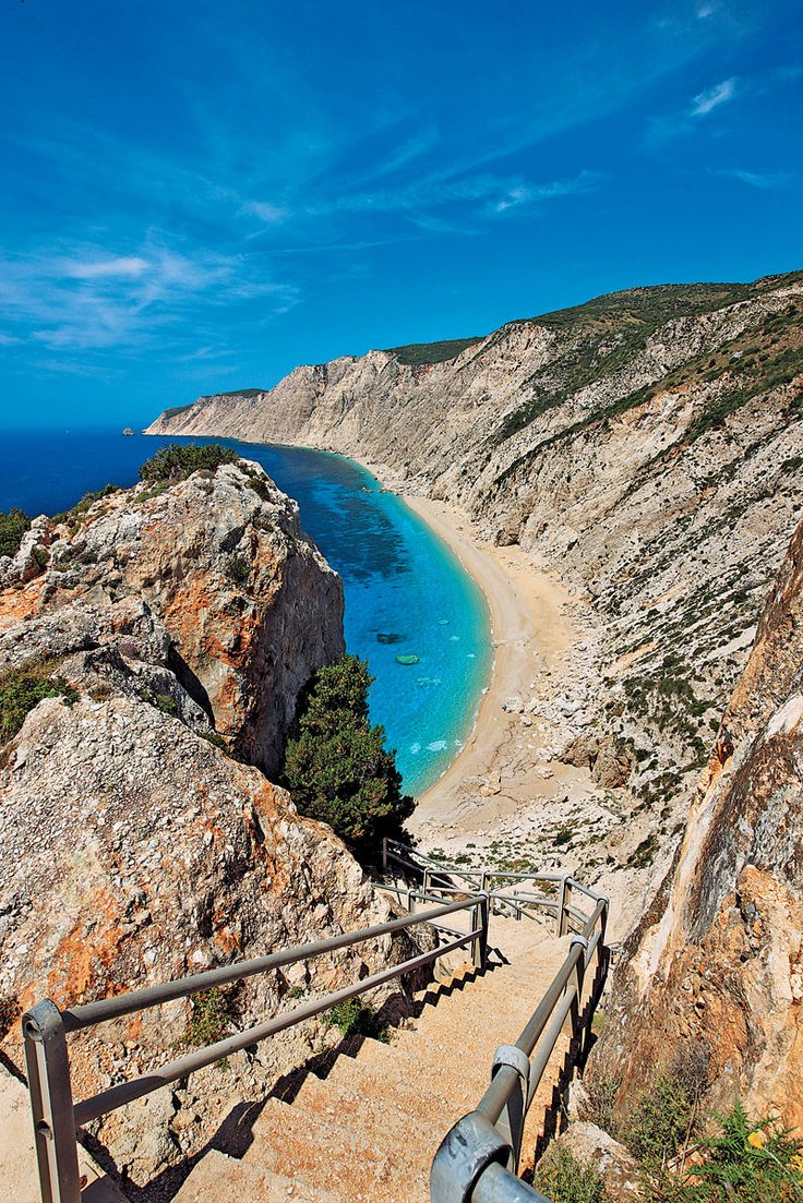 Platia Ammos, Kefalonia, Greece. One of the most impressive beaches of Kefalonia stretches at your feet. And the view is breathtaking! Although it is no longer completely unknown to tourists, the 400 plus steps one has to go down to get there, make for quite an adventure.