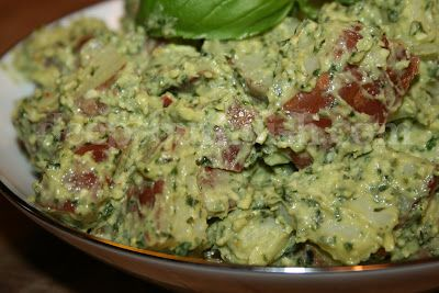 Potato salad made from small red potatoes, and a basil pesto with parsley, dried tomatoes, pine nuts, garlic, lemon juice, and red pepper flakes and dressed with mayonnaise and Parmesan.