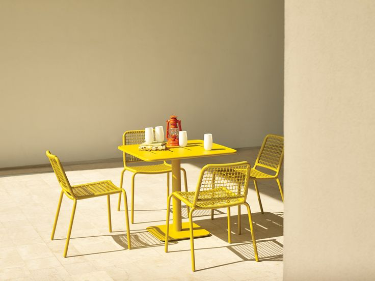 Gloster's Nomad Dining collection available at Marlanteak www.marlanteak.com