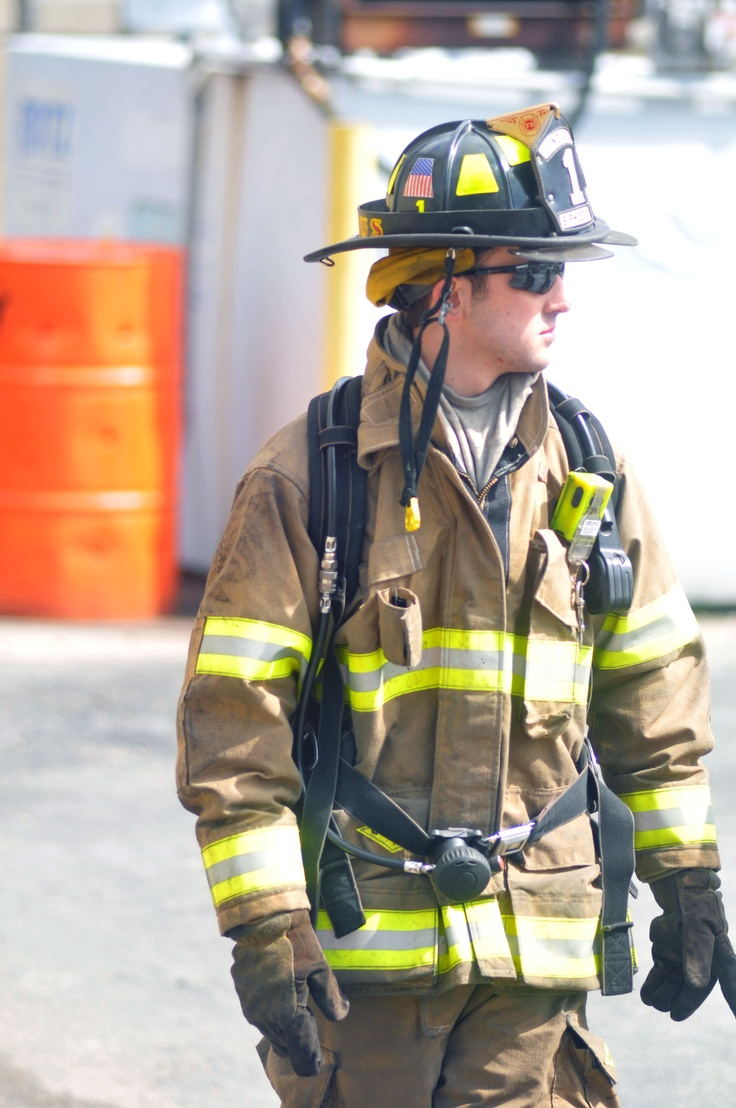 IFA Company One Firefighter Sam Phoebus walking to fireground.