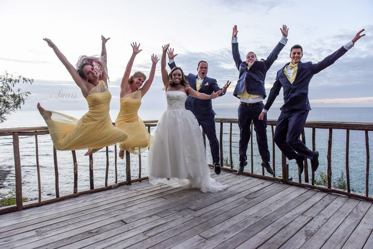 Yellow dresses for the bridesmaid and yellow ties for the groomsmen photographed by Anais Photography
