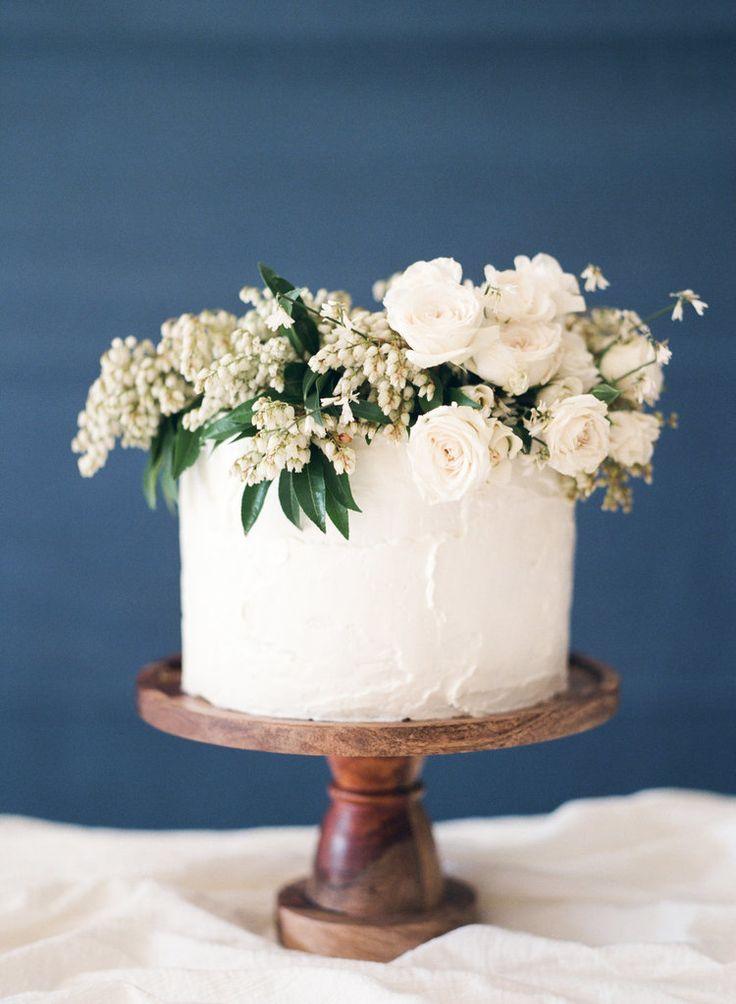 Simple Wedding Cake with an Organic Floral Topper   Heather Nan Photography   http://heyweddinglady.com/bohemian-coastal-wedding-palette-cobalt-blue-fuchsia-pink/