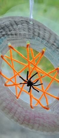 Paper Plate Spiderwebs {Kid Craft} #halloween #craft -- another variation on the paper plate spider web craft.