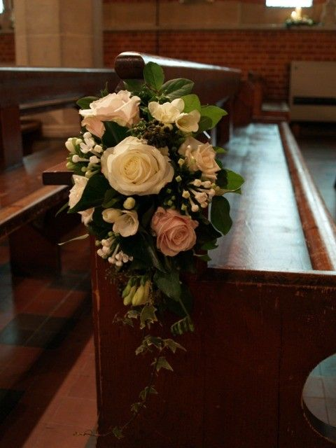 Alexandra Young Flower Design - All Saints & St Mary's  White roses, white bouvardia, freesia, pink roses, ivy and salal leaves.