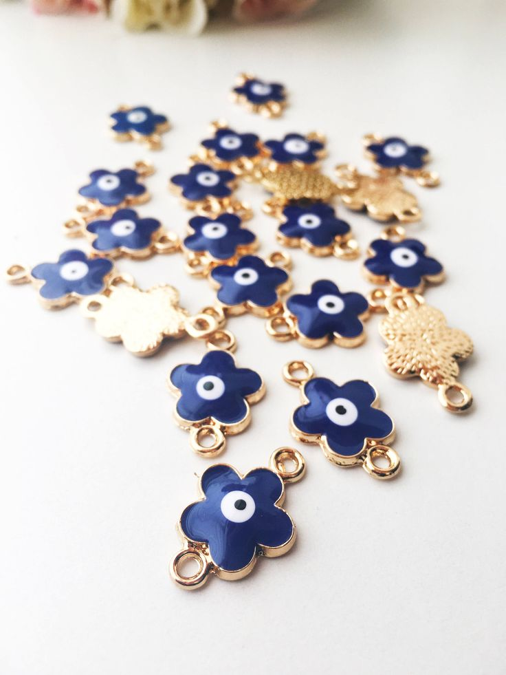 A personal favourite from my Etsy shop https://www.etsy.com/listing/529979591/four-leaf-clover-evil-eye-charm-5-pcs Four leaf clover evil eye charm, evil eye clover connector, enamel evil eye beads, good luck charm, clover connector, evil eye jewelry Hole size: 2mm Pendant size: 18mm  Pendant + holes: 22mm #evileye #evileyes # clovercharm #goodluckcharm #fourleafclover #diy #evileyecharm #evileyejewelry