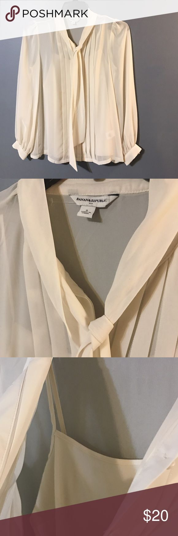 Banana Republic Blouse Like new condition trendy Blouse by Banana Republic. Cute tie around neckline. 100% polyester. Tank top underneath. Buttons down. Banana Republic Tops Blouses