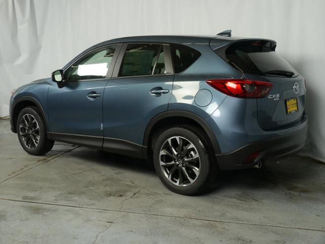 New 2016 Mazda Mazda CX-5 for sale in Brooklyn Center MN at Luther Brookdale Mazda dealership near Minneapolis, Golden Valley, Plymouth, Bloomington MN, Wayzata, Hopkins. New CX-5 for sale in Blue Reflex Mica. New Mazda for sale. Mazda for sale.
