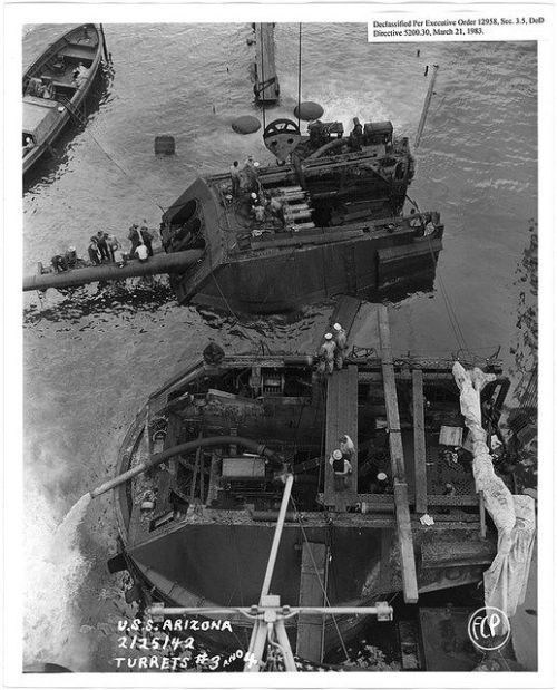 Salvaging gun turrets #3 & #4 of USS Arizona. This is one of a collection of photographs of operations at Pearl Harbor Naval Shipyard taken by the shipyard, February 25th, 1942.