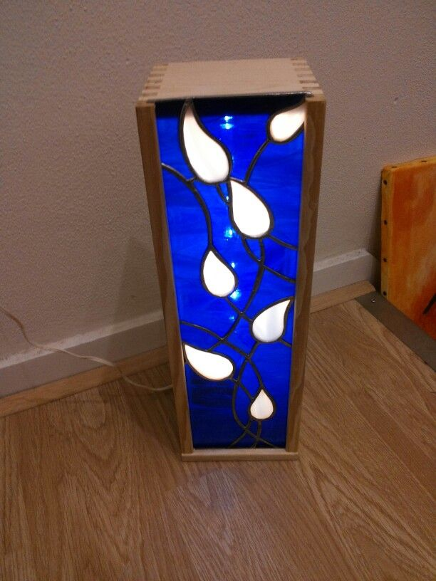 A stained glass lamp made out of a winebox.