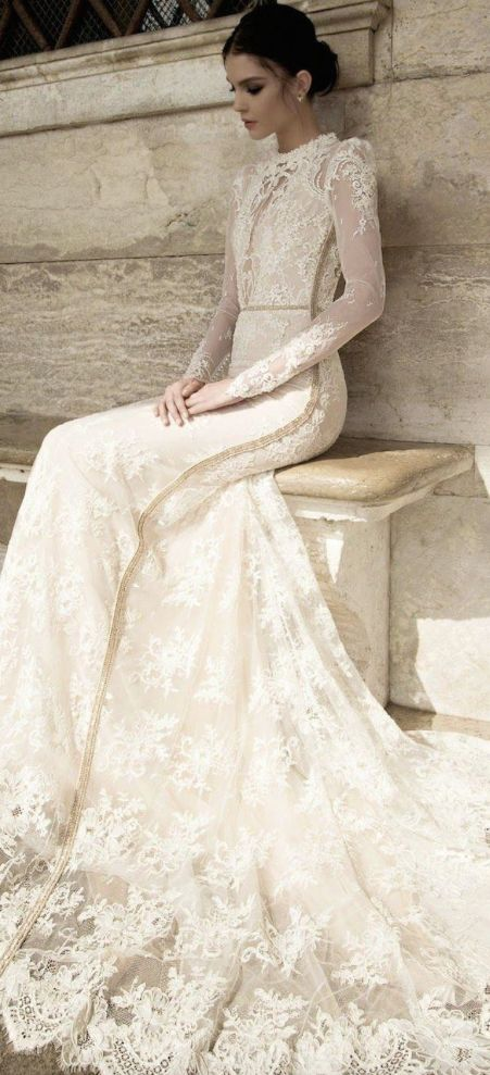 Long-sleeve embroidered wedding dress with high neckline; Featured Dress: Inbal Dror