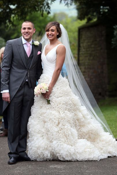 The Olympic athlete marries childhood sweetheart Andy Hill