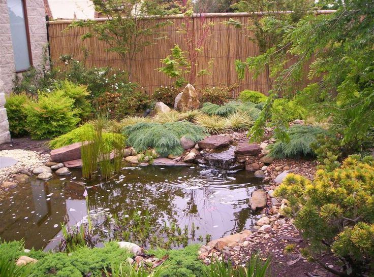 Building a pebble beach in a garden pond japanese for Japanese garden pond design