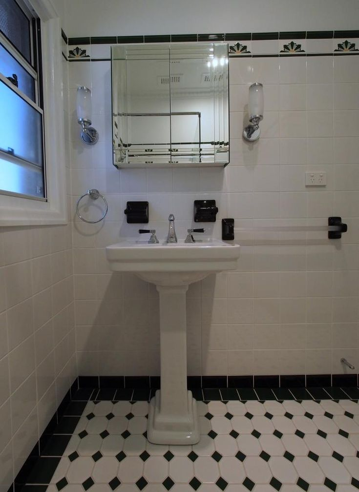 Pedestal basin, custom made bevelled edge mirror cabinet, lever Brodware taps and spout.