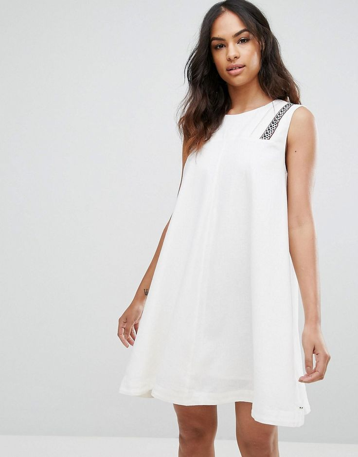 Get this TOMMY HILFIGER DENIM's casual dress now! Click for more details. Worldwide shipping. Tommy Hilfiger Denim Trapeze Shift Dress - White: Casual dress by Tommy Hilfiger, Linen-rich fabric, Crew neck, Embroidered detail, Keyhole back, Regular fit - true to size, Machine wash, 55% Linen, 45% Viscose, Our model wears a UK S/EU S/US XS and is 175cm/5'9 tall. Tommy Hilfiger is a global brand with a classic/cool American heritage. Think timeless, preppy Americana, updated, re-imagined and…