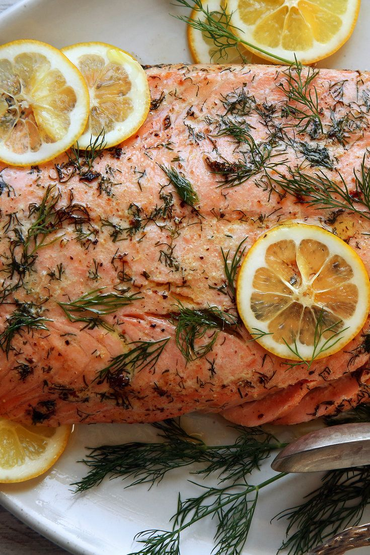 This simple fish dish is best made with wild salmon, but it works equally well with the farmed sort. It's astonishingly easy. In a hot oven, melt butter in a skillet until it sizzles, add the salmon, flip, remove the skin, then allow to roast a few minutes more. (Photo: Jim Wilson/The New York Times)