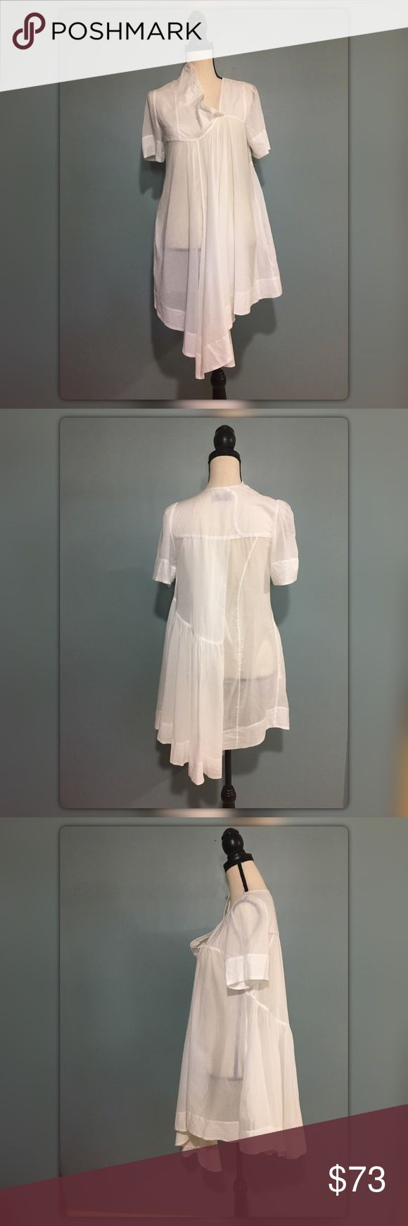 Allsaints spitafields UK sz 8/USA sz 4 agena dress AllSaints summer AGENA dress in white. Dress is very interesting style, with asymmetric hem, with asymmetric angled V-neck and faux button holes. Made of fine semi sheer cotton material (light & floaty with short sleeves). Dress also has two side seam pockets. Great condition, no stains, no pulls, no damage at all, worn not very much. Great for summer and going on vacations. Could also be worn as tunic since dress is on short side or as a…
