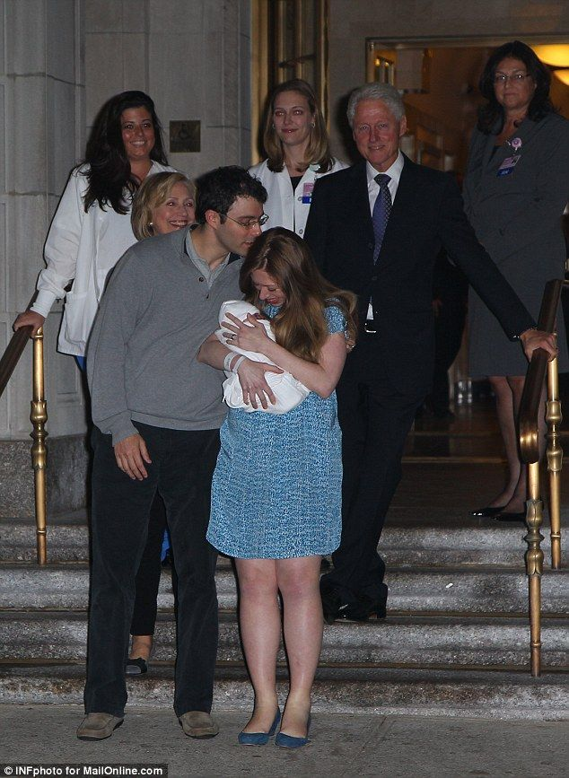 All together: Proud grandparents Bill and Hillary Clinton were present when Chelsea checked out of Lenox Hill Hospital tonight, 29 September 2014, with the latest addition to the Clinton clan, Charlotte Clinton Mezvinsky.