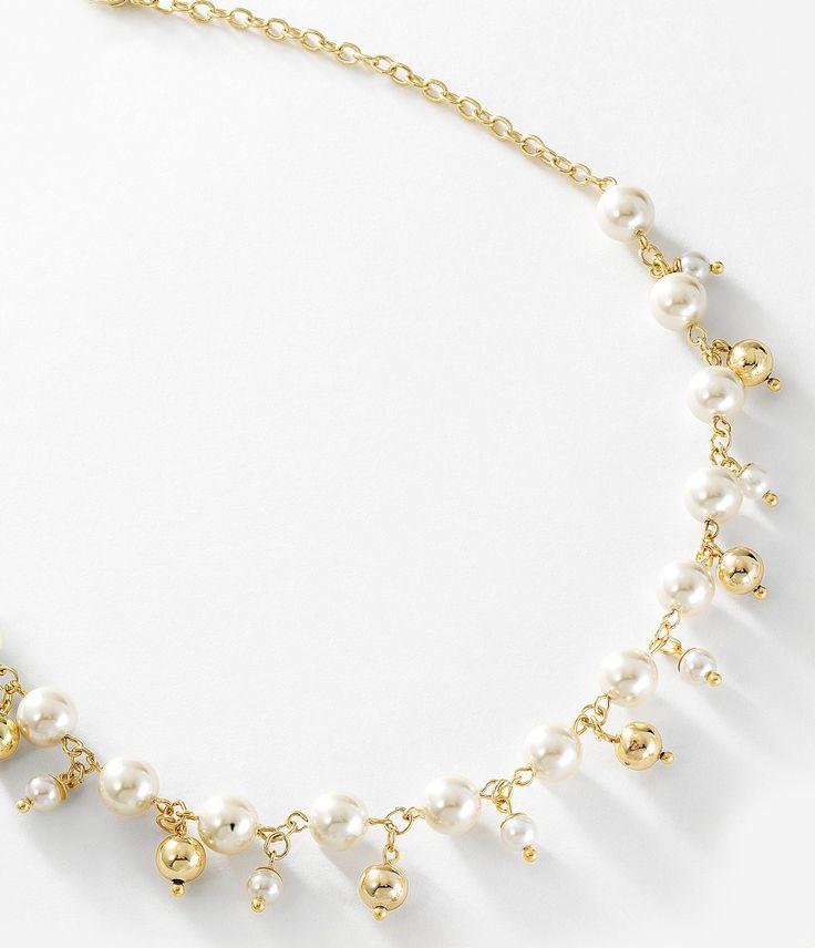 Collar en 4 baños de oro de 18 kt con cuentas de perlas en color natural. Modelo 415432.