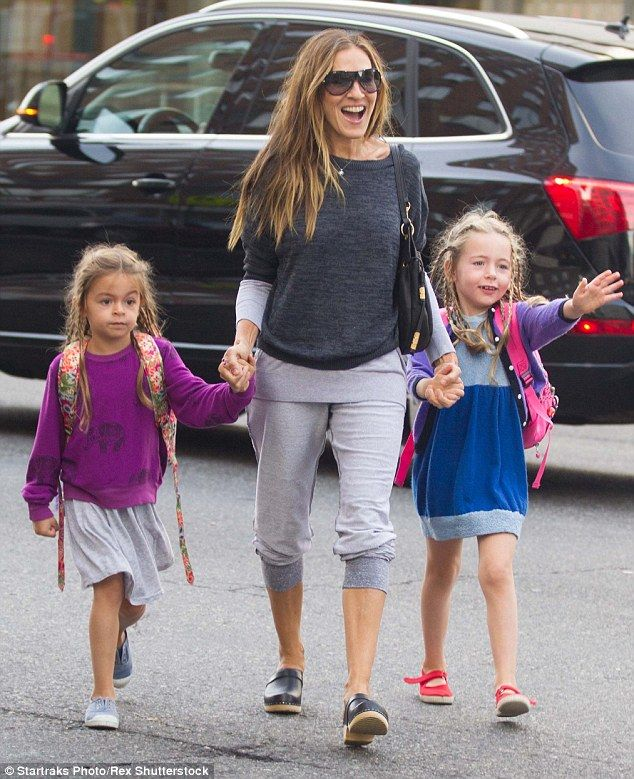 Hands on mom: Sarah Jessica Parker clearly enjoyed walking her twin daughters Marion and Tabitha to school on Monday