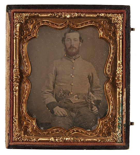 Sixth Plate Ambrotype of Early Tennessee Cavalryman.  Likely Captain N. C. Langford of Ashby's 2nd Tennessee Cavalry.  This is a clear plate ambrotype backed with dark velvet.  He is armed with a War of 1812 era saber and holstered Colt Navy revolver.