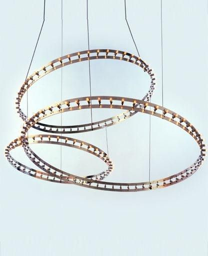 The Citadel Composition Set Suspension Lamp has been designed by Jan Pauwels for Quasar. This fixture is composed of three rings composed of Copper, brass or Matt Nickel.Illumination is provided 156 x 1.2W E10 Halogen bulbs (not included).
