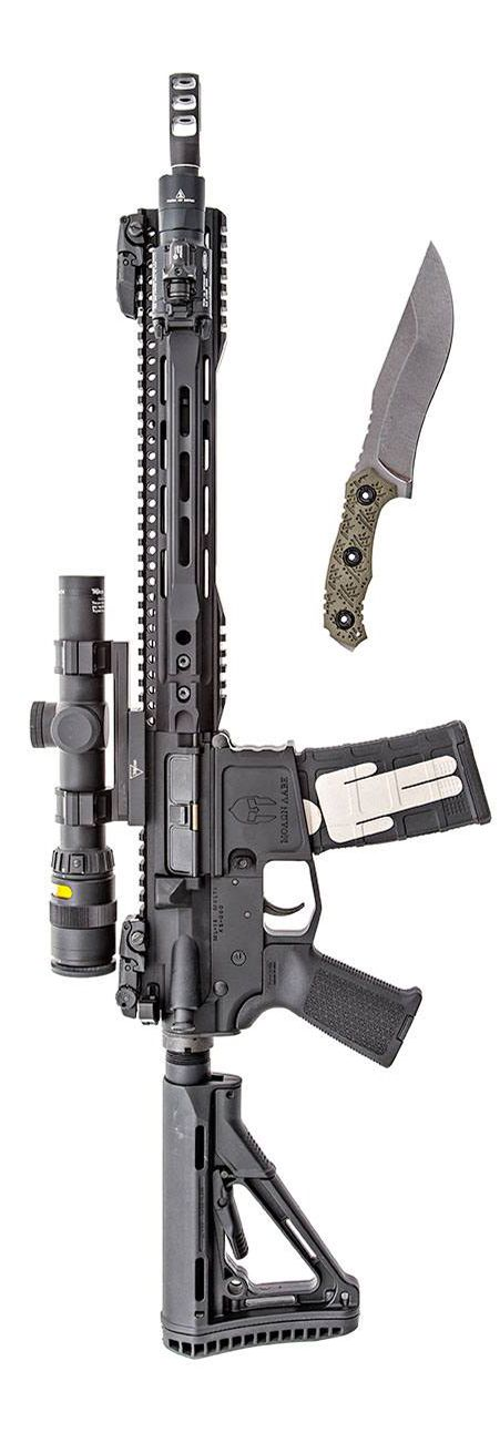 Trijicon, Parallax Tactical rail, Midwest Industries billet receiver, Joe Bob Outfitters.com billet lower, Fortis Manufacturing muzzle device, SureFire, LLC x400, and Magpul...The blade is from American Kami. Photo by Stickman.
