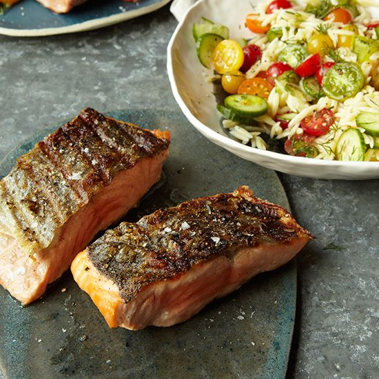 Grilled Salmon with Orzo Salad | More than one tradition is at work here. Dill and cucumber, mated in several cuisines, unite in a Greek-inspired salad, while salmon and dill are a typical Scandinavian pairing.