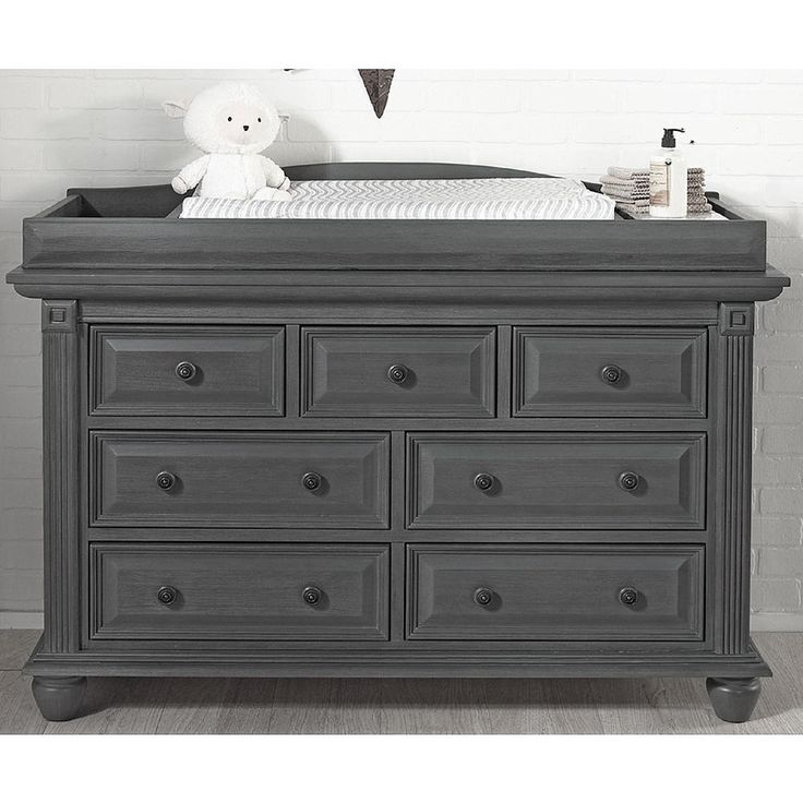Add essential storage space to your baby's nursery with the Oxford Baby London Lane 7 Drawer Dresser in Arctic Gray. This premium furniture piece features 7 drawers perfect for baby's clothing and other essentials. The Oxford Baby London Lane 7 Drawer Dresser coordinates with other furniture pieces in the London Lane collection including the 4-in-1 Convertible Crib, Changing Topper, Hutch, Nightstand and Chifferobe, each sold separately.<br><br>The Oxford Baby London Lane 7 Drawer Dresser…