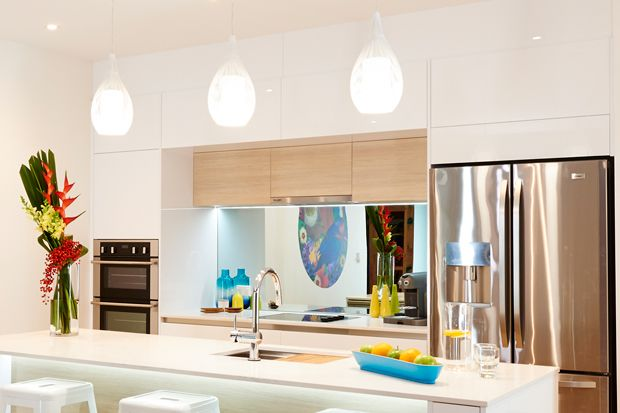 The splashback mirror helps make the kitchen feel more spacious..KITCHEN/DINING MAREE AND JAMES....THE BLOCK NZ 2014.....