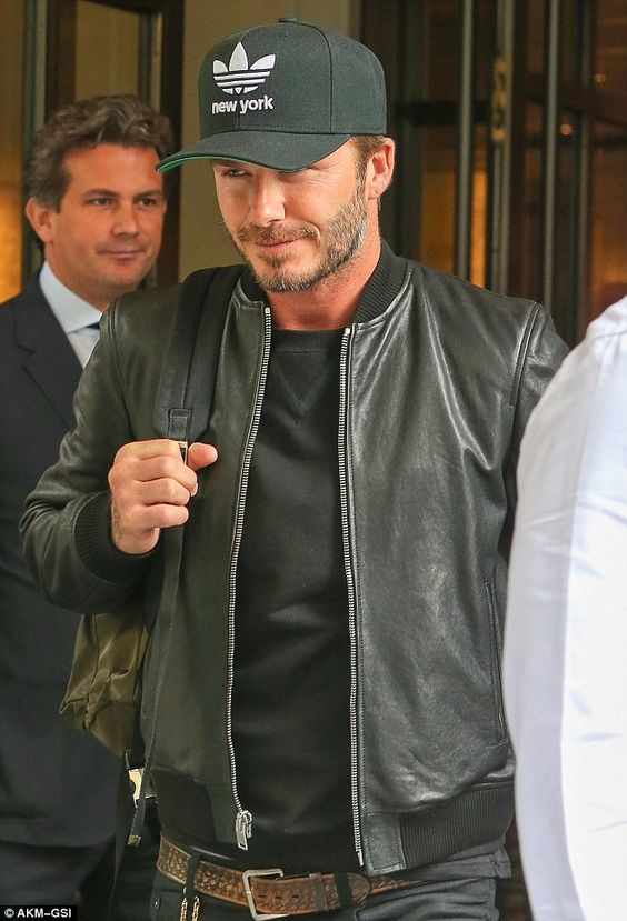 Keep it under your hat: Beckham displays his love of New York courtesy of his Adidas baseball cap: