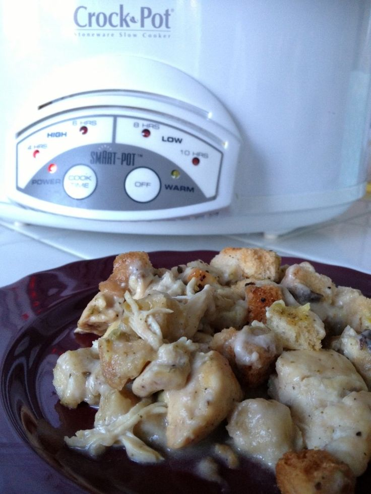 A crock pot chicken recipe made with only four ingredients: chicken, stuffing mix, sour cream, and cream of mushroom soup. A family favorite!