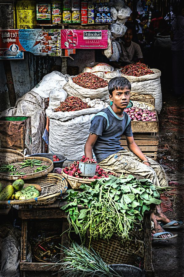 Boy seling spices and vegetables at the main market in Sittwe, Rakhine State, Myanmar.