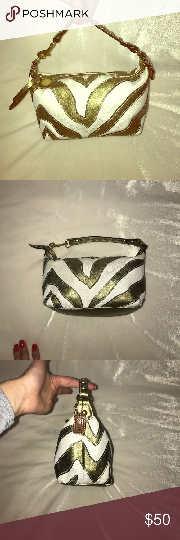 """COACH HANDBAG Gorgeous Coach hand bag. Colors are metallic gold and white. Strap has golden studs all over. Measurements are as follows 7"""" long 4.5 height 4 wide and strap hangs about 5.5"""" perfect colors for any outfit!! Slightly worn. Coach Bags Mini Bags"""