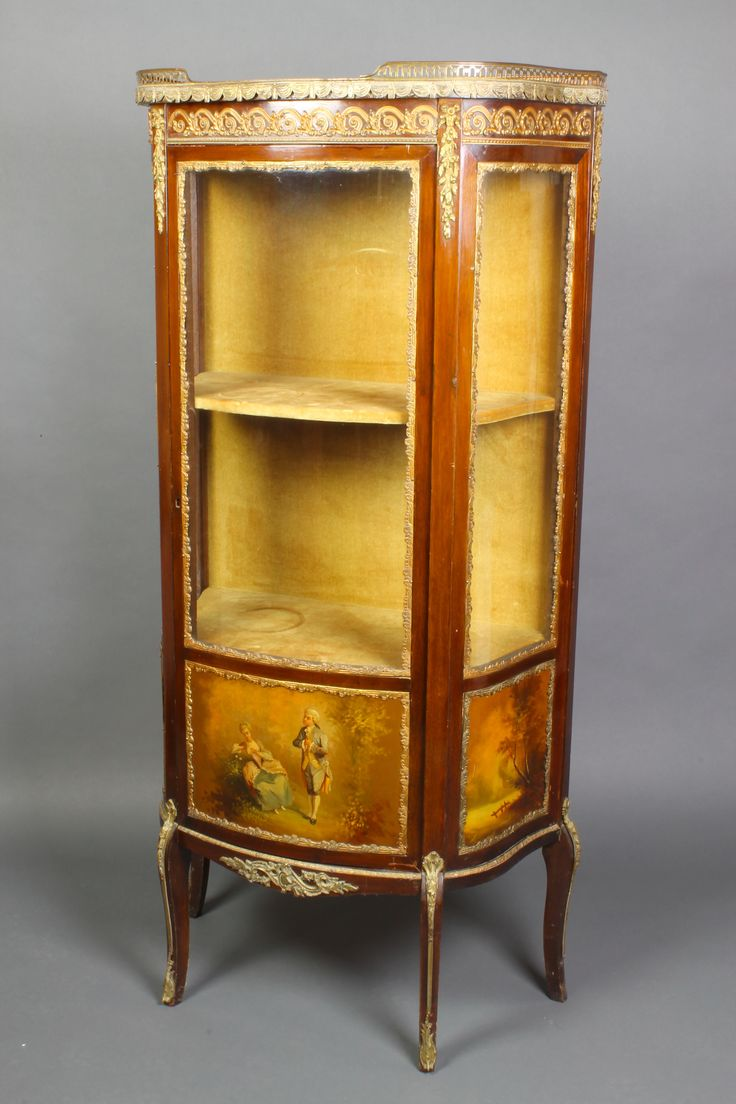"""Lot 833, A Louis XV style vitrine with pierced three-quarter gallery, fitted shelves enclosed by panelled doors, the base with 3 painted panels, raised on cabriole supports with gilt metal mounts throughout, 55""""h x 26""""w x 12""""d est £200-400"""