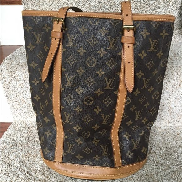 -pending sale- Louis Vuitton LARGE bucket bag This is the largest of the Louis Vuitton bucket bags.  Has some ripping at the top of the inside of the bag as you can see in photo. This bag has wear on the inside but still in good condition on the outside. Priced to sell!!! Please make offers (cheaper on Ⓜ️erc) Louis Vuitton Bags Shoulder Bags