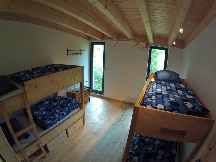 Our 4 person #rooms have wooden bunk #beds with down pillows and blankets. Underneath the beds are boxes for storage. There are several hanger per room to dry up your gear. Our #ecological #geothermal heat system keep the #house cozy and warm.  Welcome to the #freerider's #lodge and #hostel in #andermatt, #swiss #Alps  www.basecamp-andermatt.com