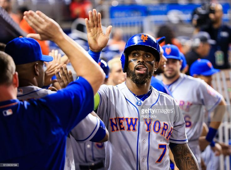 Jose Reyes #7 of the New York Mets celebrates with teammates after scoring a run during the game against the Miami Marlins at Marlins Park on September 27, 2016 in Miami, Florida
