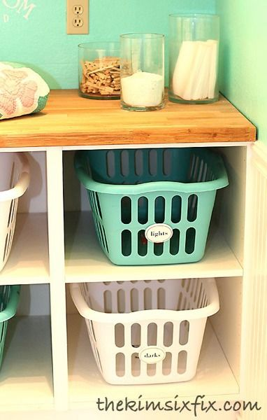 Laundry basket cubbies made from Ikea Cabinets without doors.  The shelves are adjustable so you can fit ANY SIZE basket!