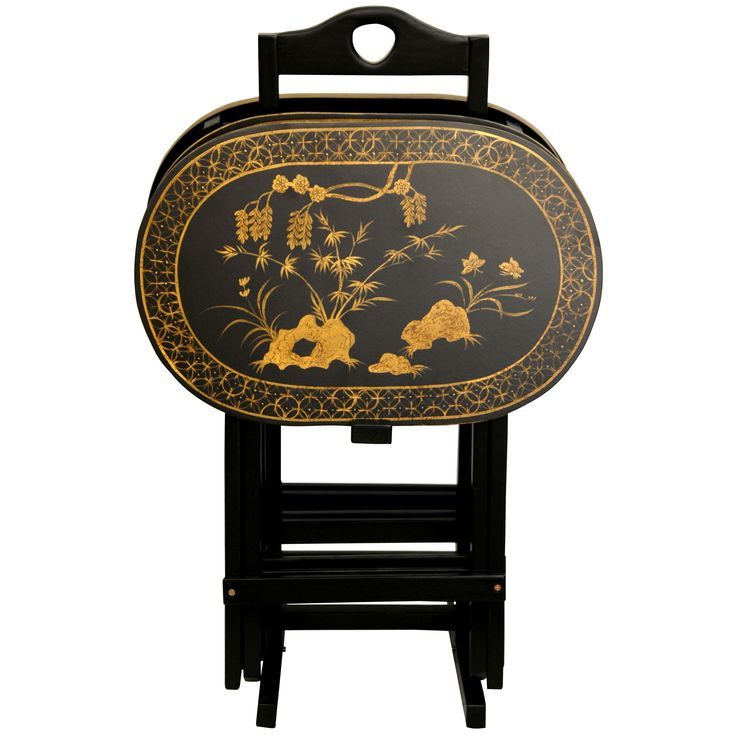 Dine in style in front of the TV or serve party guests on these hand-painted black TV trays made of fine solid rosewood. This set of four features a stunning, Asian-themed art motif in gold and is lacquer-finished for stain- and water-resistance.