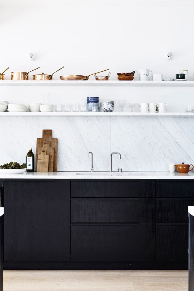 Marble wall / open shelving / black cabinets