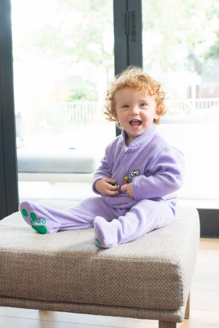 Logan wearing a lilac fleece kiddigrow