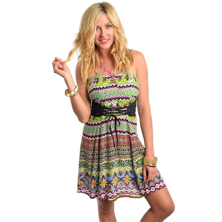 Flirty spaghetti strap dress features a bold pattern print