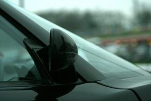 Clean hard water spots from your auto glass promptly.