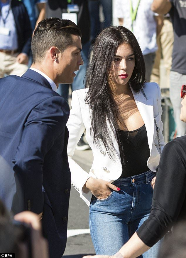 Ronaldo and his model girlfriend Georgina Rodríguez pictured at Madeira airport - which has been renamed the Cristiano Ronaldo International Airport in his honour