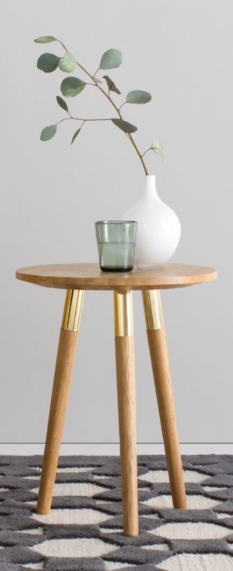 BRASS ACCENT The table has three legs, each one accented with a brass cuff. The trend-led touch makes a striking focal point and contrasts beautifully with the rustic oak.