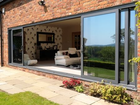 6 panel triple track aluminium patio door Ours would be 4