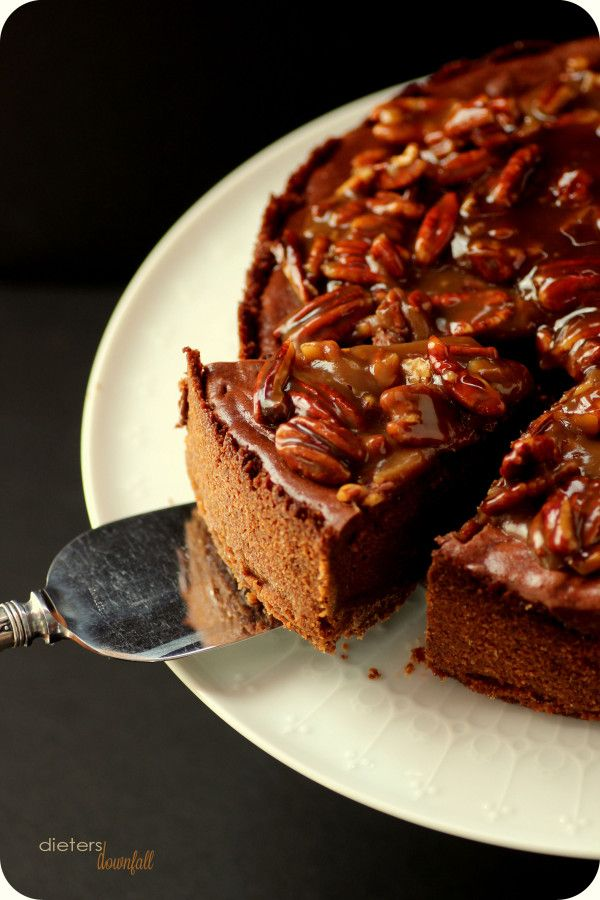 Rich Chocolate Cheesecake topped with sweet Praline Sauce. from #dietersdownfall.com