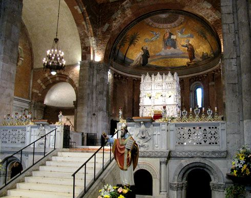 """The sanctuary of the Church of San Pietro in Ciel d'Oro (""""St Peter's with the golden ceiling"""") in Pavia (near Milan), Italy. In the centre of the image, the white marble structure is the """"Arca"""" (tomb) that contains the bones of St Augustine."""