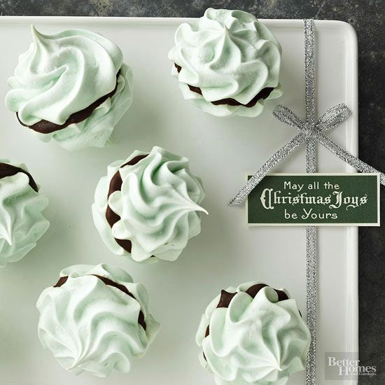 Make light-as-ever meringues kissed with mint. For the ultimate bite, sandwich semisweet chocolate between two crisp meringues. Be sure to have your green food coloring handy while baking -- things are about to get festive!/