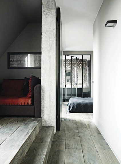 ZUEmagazine: A PARISIAN LOFT We do love stylish interiors. Combination of an old and new looks brilliant. Grey wooden floor is simply our favourite and with a touch of red color it makes a beautifil home. Who wouldn't like to live there ?